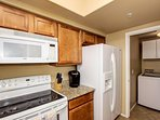 Laundry room with washer and dryer off kitchen