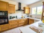 halogen hob, full sized oven, fridge freezer, washing machine, microwave, cutlery & crockery