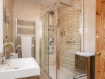 Our 'bath' room is actually a Shower Room, with a fantastic shower-tower to invigorate and cleanse!