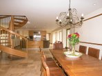 Large open plan kitchen diner with spiral staircase leading to first floor