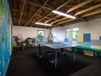 The games room with table-tennis, darts and board games.