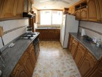 Large kitchen with latest appliances, large fridge  and granite counter