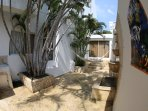Second interior patio with large coral stone water fountain and two hammocks. Great siesta spot!