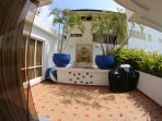 Front patio with coral stone water fountain, bar-b-q and step to pool and best beach in Cartagena