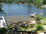 Two docks, beach, swim area.