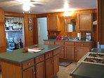 Kitchen. Gas range, center island, double sink.