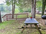 Fire up the charcoal grill for the ultimate BBQ at the lakefront picnic table