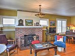 Guests can warm up by the fireplace in the living room.