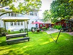 Large private back yard and garden includes a hammock, picnic table and several seating areas.