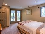 This bedroom offers a comfortable queen bed and access to the large deck.