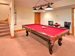 Shoot some pool in the downstairs game room.