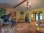 Upon entering this elegant home, you'll be charmed by the luxurious decor that fills the sitting room.
