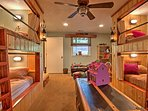 Kids will love sharing this room with 3 built-in bunk beds and plenty of toys and books.