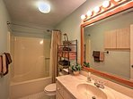 Rinse off in the shower/tub of this pristine bathroom.