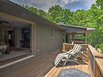 Open up the double doors to access the 3 tiered deck and overlook the beautiful landscape.