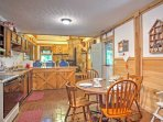 The dining table in the kitchen can comfortably seat 4 guests.