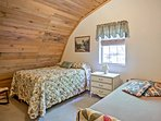The first bedroom features a full bed and a twin bed.