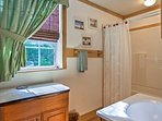 The cabin features 3 full bathrooms.