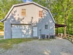The large driveway has parking available for several vehicles as well as a boat trailer at this converted cabin...