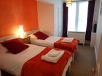 The fourth bedroom has two  full size single beds