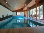 The private indoor heated 10m pool with doors and windows to the south onto the garden