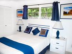 Your room is bright and airy and decorated in blue and white with splashes of orange