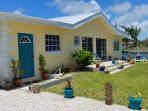 The house is located not just across from the beach, but also on the bank of an inland waterway.