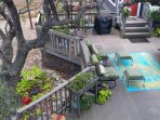 View of 2nd deck from the top deck with propane BBQ and covered grilling area
