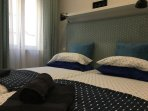 Double Room, with beds of 2 mts long and two diferent types of Pillows.