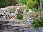 Pretty terraced garden with barbecue