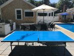 The outdoor ping pong table is a big hit with families and the outdoor kitchen offers a gas BBQ and side burner, a...