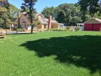 At the rear of the house there is a large grassed lawn with a post and rail fence and gate separating the lawn from the...