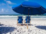 Complimentary beach service with two chairs and an umbrella