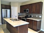 Gourmet Kitchen with Stainless Appliances incuding Dishwasher