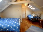 Upstairs bedroom with queen bed and single day bed. This bedroom has an en suite.