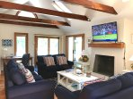 The large modern family room overlooks the private pool and patios comes equipped with a 55' HD Smart TV.