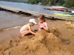 Building a mermaid in the sand. So much fun.
