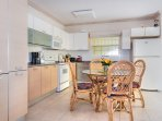 Bright kitchen; table for 4-6 (extra chairs available). Large fridge and freezer with ice cube maker