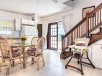 Beautiful, bright kitchen. Door to patio, other door to Sand street; high chair; internal stairs