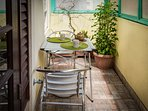 Small patio with French door to kitchen, ideal for breakfast and lunch