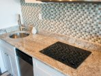 Granite throughout, glass back splash accents