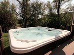 Hot tub for 2 people located right off of the front deck