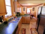 Kitchen w/stainless steel gas range, refrigerator, dishwasher. Fully stocked with dishes & pans