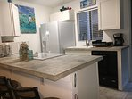 kitchen with seating for 4 and fully stocked. dishwasher,microwave,large refrigerator,coffee maker