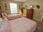 Twin Bedroom w/Two Twin Beds & Flat Screen TV