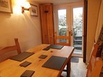 Dining room with doors to the garden.