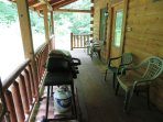 Covered back deck is equipped with a gas grill