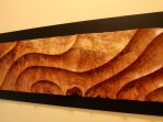 wonderful original artwork through out the suite.  Wavescape a hand carved wall sculpture.