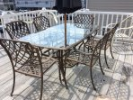 Extra Large Front Deck with seating for 6 at the table plus 4 more chairs.