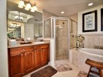 Separate his and hers vanities and walk in shower.